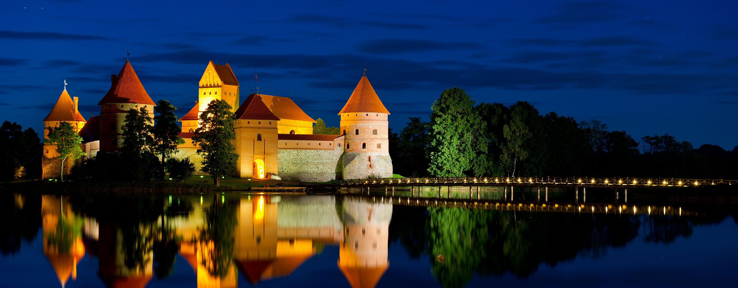 car hire rental lithuania castle at night