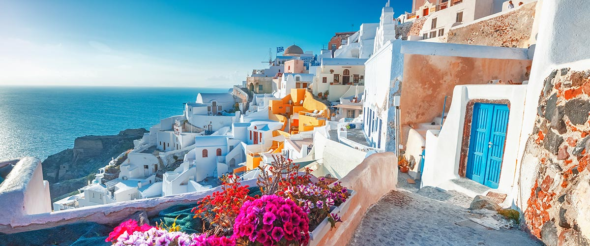 car hire rentals Greece white houses at the beach