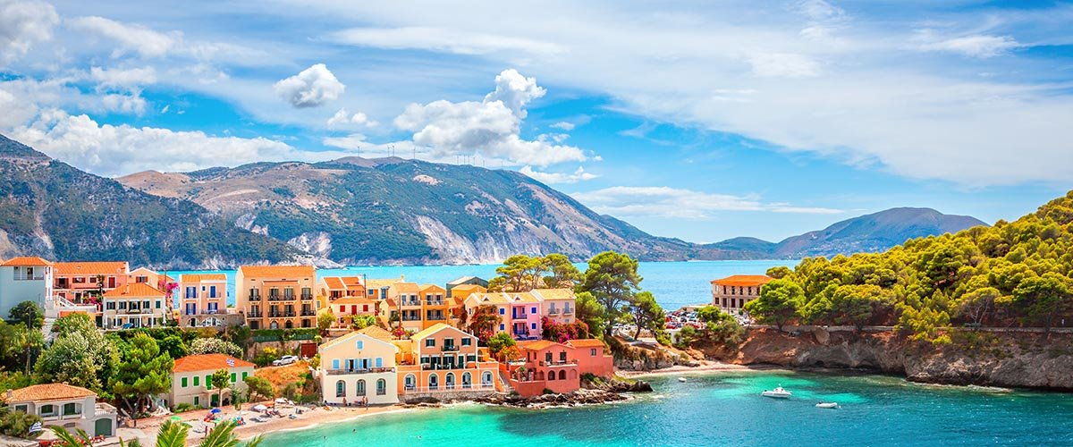car hire rentals Greece colorful houses at the beach