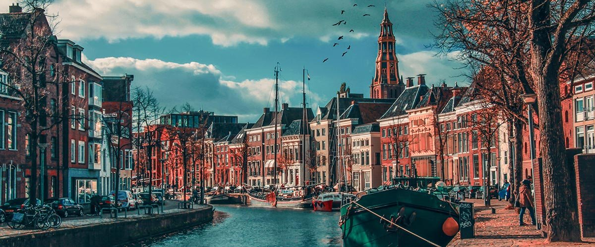 car hire rentals Netherlands city river birds